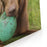 A Chocolate Labrador Holds A Green Ball Canvas Wall Art Print