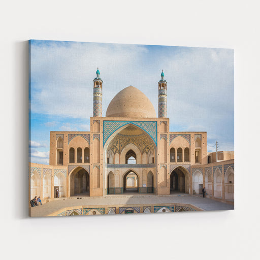 A Symmetrical View Of The Mosaic Work And Sandstone Colored Islamic Architecture Of The Agha Bozorg Mosque In The Desert City Of Kashan, Iran, During The Sunset Golden Hour Canvas Wall Art Print