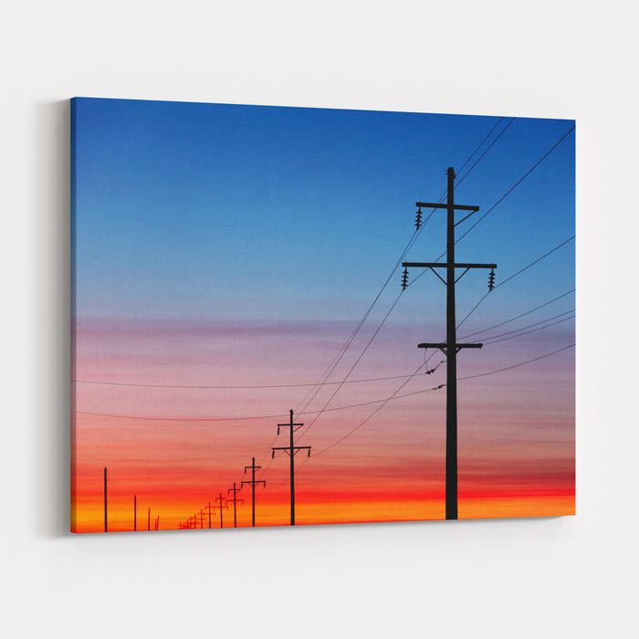 A Silhouette Of High Voltage Power Lines Against A Dramatic And Colorful Sky At Sunrise Or Sunset Canvas Wall Art Print