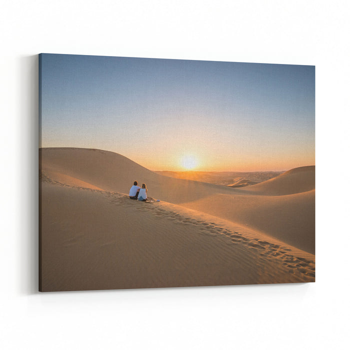 Desert Landscape With Young Couple  Looking At Sunset Canvas Wall Art Print