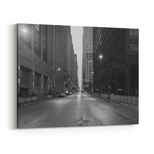 A Black And White Photo Of Downtown Chicago The Shot Is Taken From The Middle Of The Street Canvas Wall Art Print