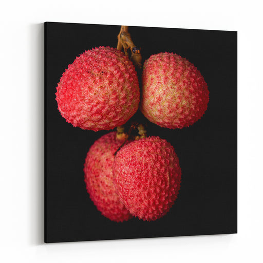 A Bunch Of Lychees Against A Black Background Canvas Wall Art Print