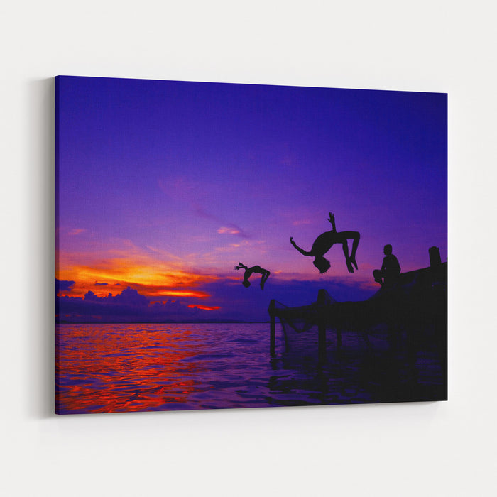Kids In Silhouette Doing Backflip Jump To The Water Canvas Wall Art Print
