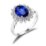 Load image into Gallery viewer, Kate Sterling Silver Blue with Clear Accent CZ Birthstone Engagement Ring Ginger Lyne Collection