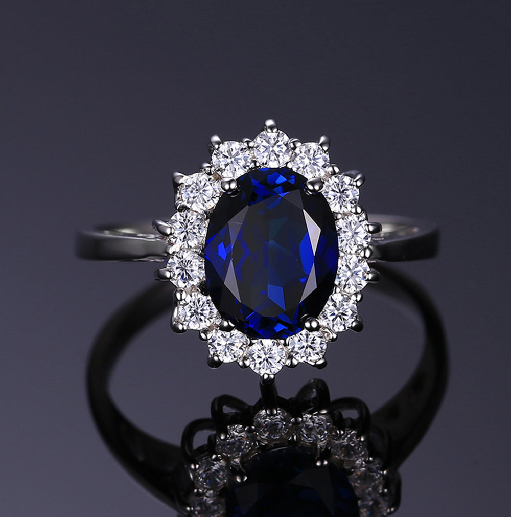 Kate Sterling Silver Blue with Clear Accent CZ Birthstone Engagement Ring Ginger Lyne Collection