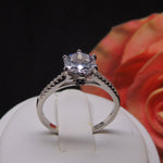 Load image into Gallery viewer, Merci Sterling Silver 7mm Solitaire Blue Accent CZ Engagement Wedding Bridal Ring Ginger Lyne Collection