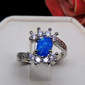 Montana Oval Shape Blue Simulated Fire Opal Clear CZ Ring Ginger Lyne Collection