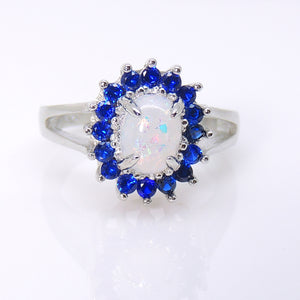 Reese Oval Shape Simulated Fire Opal with Blue CZ Accents Ring - Ginger Lyne Collection