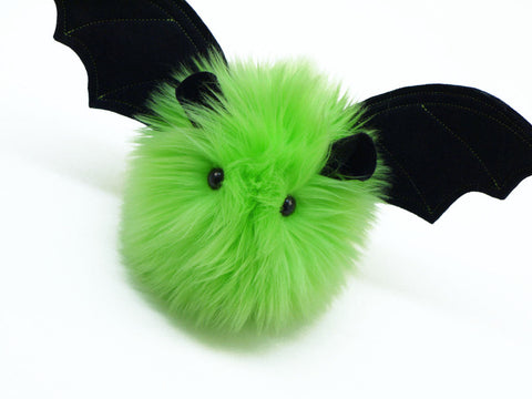 Beetle the lime green bat stuffed animal plush toy angled view.