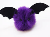 Bella the purple bat stuffed animal plush toy angled view.