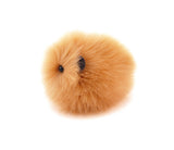 Honey the tan guinea pig stuffed animal plush toy side view.