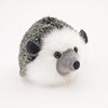 Hemingway the black and grey hedgehog stuffed animal plush toy angled view.