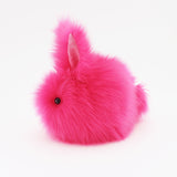 Petunia the Hot Pink Easter bunny plush toy, side view.
