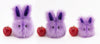 Lavender the Easter bunny plush toy, group view with apple showing scale.