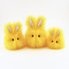 Sunny the Easter bunny plush toy, group view.