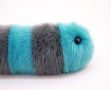 Truman the Snuggle Worm Stuffed Animal Plush Toy close up view.