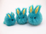 Breeze the aqua blue bunny stuffed animal plush toy group shot.