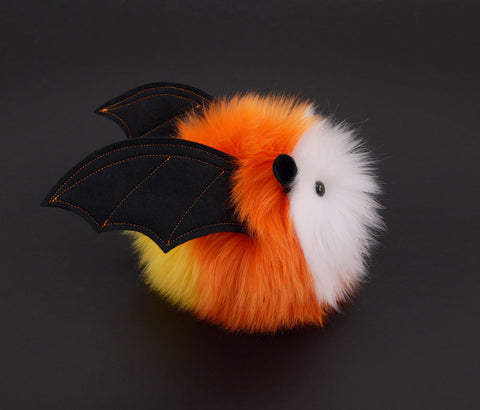 Candycorn the bat stuffed animal plush toy side view.