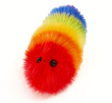 Bow the rainbow snuggle worm stuffed animal plush toy angled view.