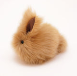 Honey the tan bunny stuffed animal plush toy side view.