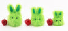 Herb the Easter bunny plush toy, scale view with apples.