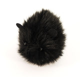 Coal the black guinea pig stuffed animal plush toy angled view.