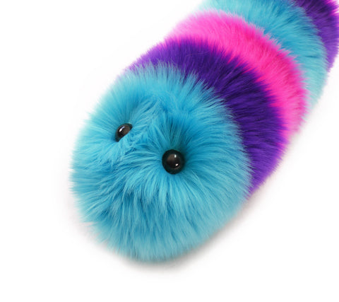 Calypso the snuggle worm stuffed animal plush toy angled view.