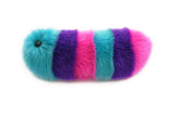 Calypso the snuggle worm stuffed animal plush toy side view.