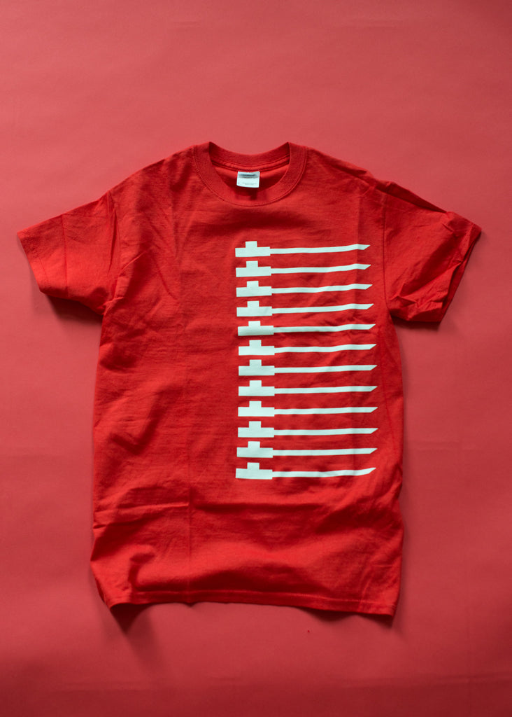 Traditional pipe design on red soft cotton t-shirt. White on red.