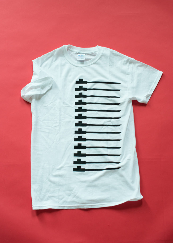 Traditional pipe design on white soft cotton t-shirt. Black on white.