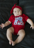 "Baby onesie with Mini-Mocs & ""Born to dance"" tagline. Colourfast, water-based inks, printed on premium American Apparel, pre-washed 100% soft cotton. colour - red. Sizes: 6-12 months,12-18 months,18-24 months"