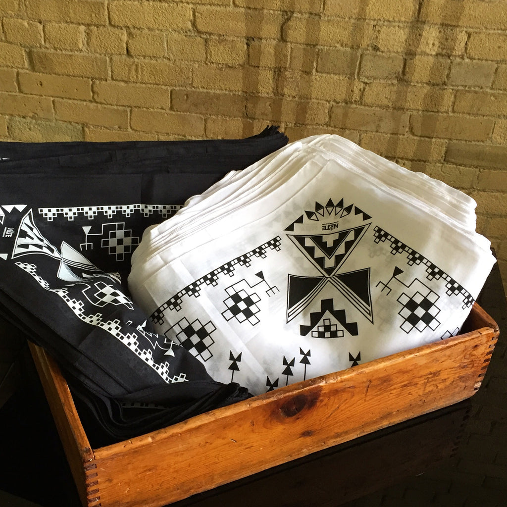 Water-based ink bandana, black and white colour options, native designs.