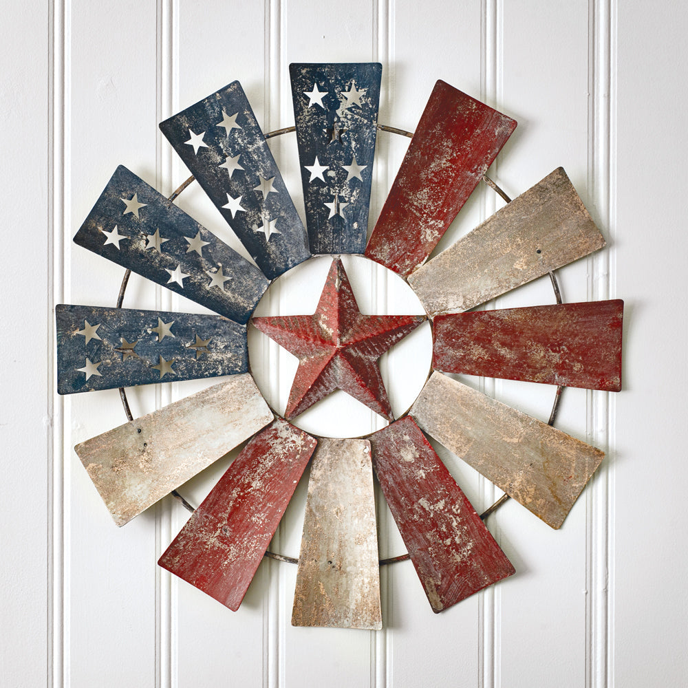 Our American Flag Metal Windmill Wreath and Wall Decor expresses a lot of country, a bit of industrial, definitely farmhouse and patriotic and Texan and so so American