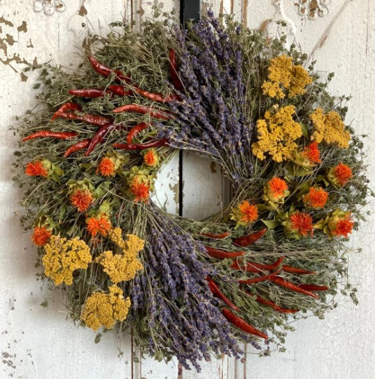 "Our Aromatic Lavender, Chili and Safflower Preserved Wreath - 15"" features a unique blend of fragrance and preserved yarrow, lavender, safflower, savory and chilies all meticulously intertwined onto a twig base… all harvested here in the USA"