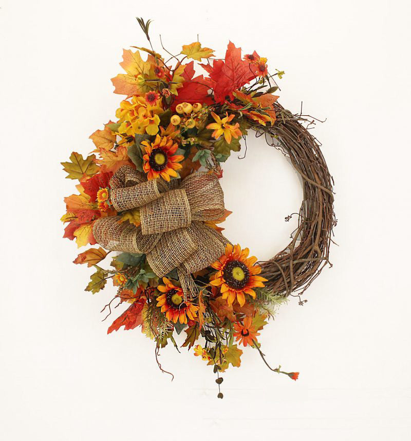 Our Autumn and Burlap Fall Front Door Wreath (23 inch)  features a grapevine wreath that that is exposed on one side and then uniquely crafted on the other side with an assortment of eye catching orange and yellow silk flowers with lots of fall colors, and a beautiful burlap bow that captures the elegance of this wreath