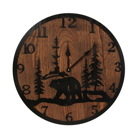 "This beautiful piece of wall décor is our Bear Handcrafted Etched Wood Wall Clock (24"") and features an etched image of a bear in the pine trees all in black on a contrasting stained wood background."