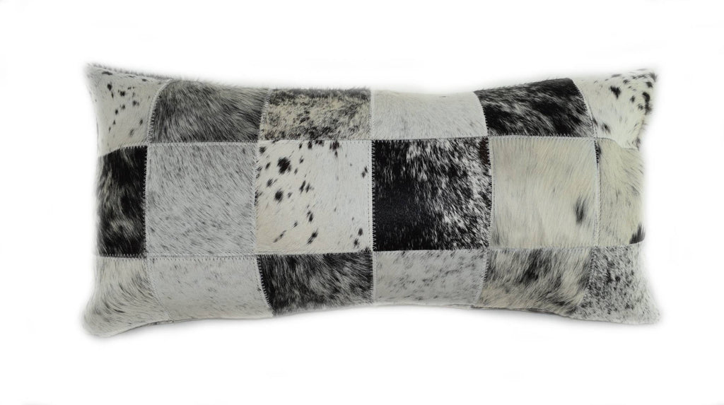 "Our Black and White Salt and Pepper Cowhide Patchwork Lumbar Pillow is 20"" long x 12"" tall and features an assortment black and white salt and pepper cowhide colors… all patchworked together to make a decorative pillow."