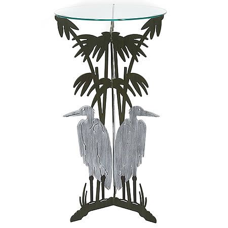"Our Blue Heron Pedestal Table Metal Art Sculpture is a stately piece hand forged here in the USA by skilled artisans. Fabricated by hand with the use of 3/16"" heavy gauge steel, then zinc galvanized to prevent rusting, and hand painted with a two-step high quality marine grade epoxy paint for weather resistant indoor or outdoor use. The very sturdy tri-legged blue heron pedestal base, once hand painted in silver and brown colors, is then fitted with a 19"" in diameter 3/8"" piece of flat glass."