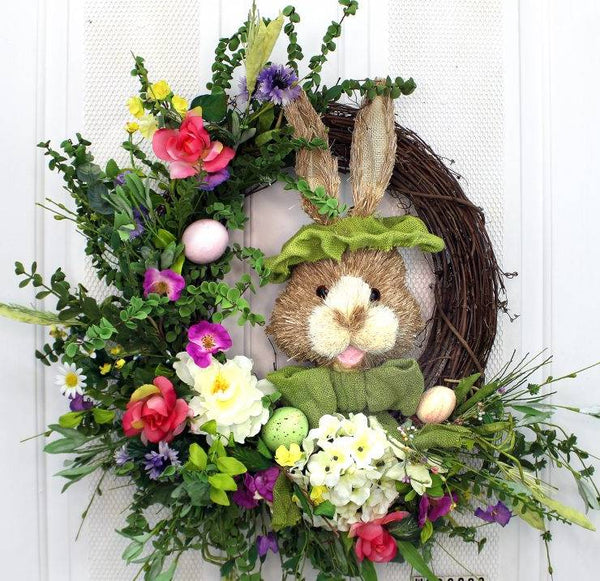 "Our Bowtie Bunny Spring Front Door is 23"" in diameter and features an array of colorful spring silk flowers as well as a festive bunny rabbit all dressed up with green brim hat and matching bowtie on an exposed grapevine base."