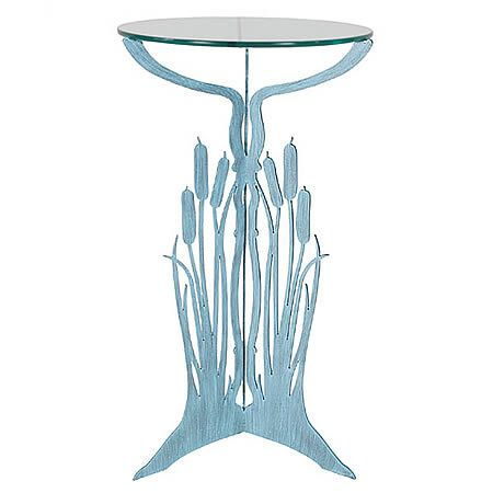 "Our Cattails Pedestal Table Metal Art Sculpture is a stately piece hand forged here in the USA by skilled artisans. Fabricated by hand with the use of 3/16"" heavy gauge steel, then zinc galvanized to prevent rusting, and hand painted with a two-step high quality marine grade epoxy paint for weather resistant indoor or outdoor use. The very sturdy tri-legged cattails pedestal base, once hand painted in soothing verdigris color, is fitted with a 19"" in diameter 3/8"" piece of flat glass."