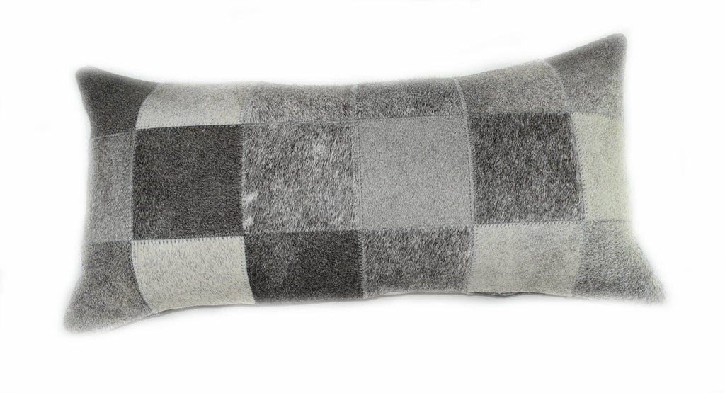 "Our Grey Cowhide Patchwork Lumbar Pillow is 20"" long x 12"" tall and features an assortment of grey cowhide colors all patchworked together to make a decorative pillow."