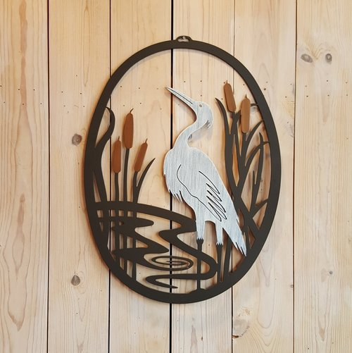 Our Blue Heron Metal Indoor Outdoor Wall Art is uniquely handcrafted in the USA by skilled artisans. Each piece is custom made to order and powder coated for outdoor use or indoor use and it captures the artist's creative beauty of this coastal bird and theme all in one magnificent wall hanging.