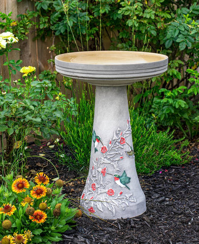 Our Hummingbird Handcrafted Clay Birdbath Set on asoft gray background is beautifully handcrafted and painted in the USA
