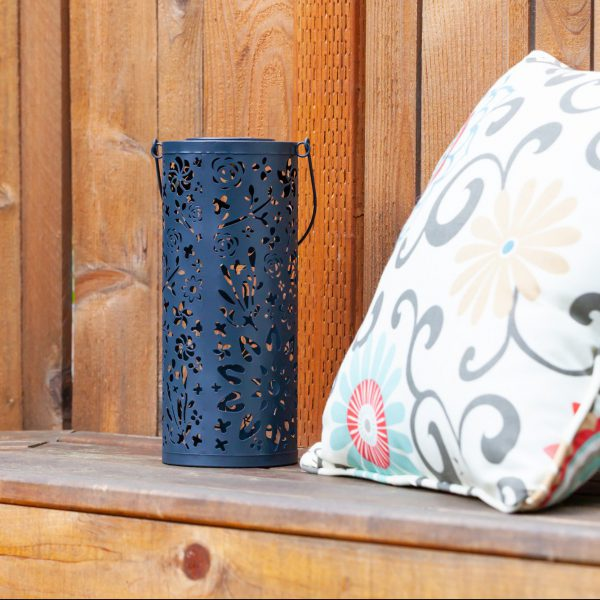 Our Midnight Blue Punched Metal Solar Lantern can be hung or added to a flat surface to reflect its the beauty of the cutouts