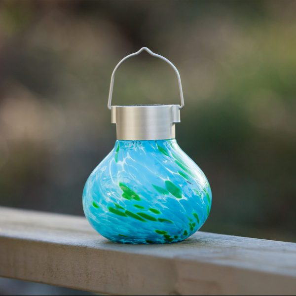 Our Mint Hand Blown Glass Solar Tea Lantern is 5.5″ tall x 4.5″ wide and has been crafted by skilled artisans using hand blown glass techniques that create such eye catching detail
