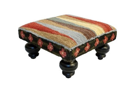 "Our Pinwheel of Stripes Handcrafted Hooked Wool Footstool features vibrant colors and is 16"" square x 8"" tall and a great accent piece to use to put your feet up after a long hard day"