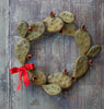 Our Prickly Pear Cactus Handcrafted Metal Front Door Wreath can be used year round. Add a bow to celebrate a special occasion.
