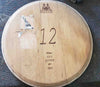 Sample of Reclaimed Wine Barrel Head Wood Lazy Susan with Winemakers Stamp before it is cleaned up and repurposed