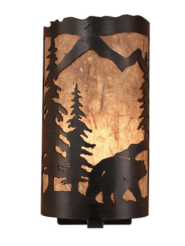 Our Rustic Bear Panel Wall Sconce captures the forested beauty of cutouts of a metal bear and trees in front of the amber parchment paper shade