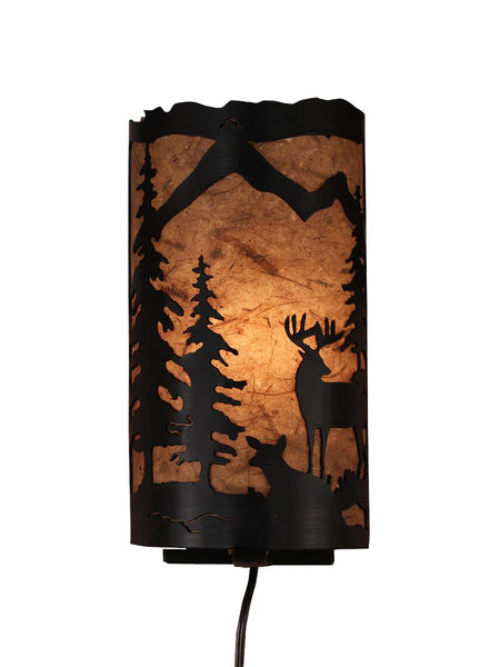 Our Rustic Deer Panel Wall Sconce captures the forested beauty with cutouts of metal deer and trees in front of the amber parchment paper shade